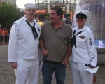 Dave from WVF giving tickets to FCI Christopher Dye and FCI Rebecca Wheeler of the USS Oak Hill for the Billy Currington Concert at the Baltimore Inner Harbor