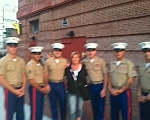 Angela with brave Marines inviting them to see Billy Currington